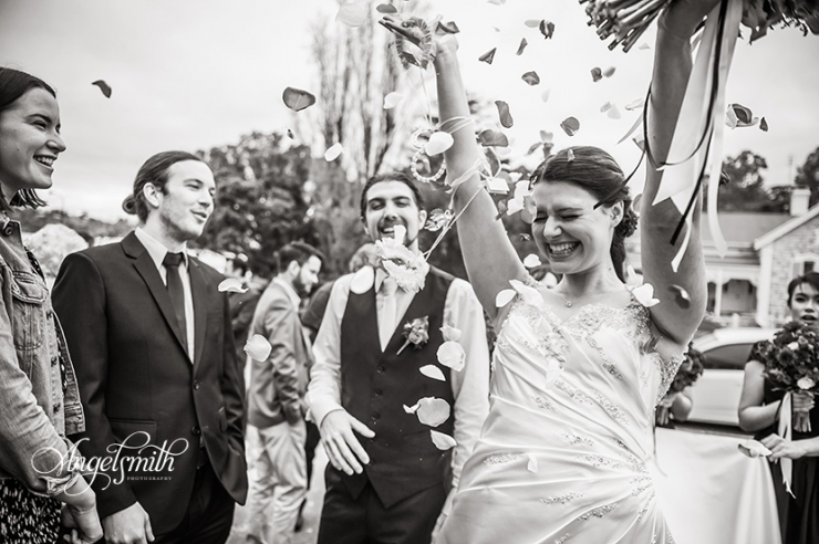 Miranda being showered with petals after her wedding to Luke